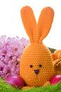 Handmade easter bunny with colorful flowers and easter eggs Stock Images