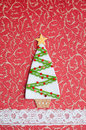 Handmade fabric christmas tree on red background Royalty Free Stock Images