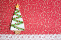 Handmade fabric christmas tree on red background Stock Image