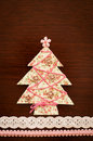 Handmade fabric christmas tree on wooden background Royalty Free Stock Image