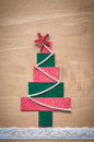 Handmade fabric christmas tree on wooden background Royalty Free Stock Photography