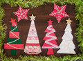 Handmade fabric christmas tree on wooden background Royalty Free Stock Photo