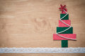 Handmade fabric christmas tree on wooden background copy space for your text Royalty Free Stock Images