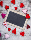 Handmade felt hearts chalkboard with Royalty Free Stock Photos