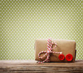 Handmade gift box over green polka dots background Royalty Free Stock Photo