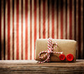 Handmade gift box over striped background with red twine cord Royalty Free Stock Photography