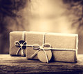 Handmade gift boxes in sepia tone on wooden board Royalty Free Stock Photography