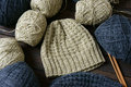 Handmade gift couple woollen hat knitting for on wintertime in black and beige color woman hand from ball of yarn wool will Stock Photos