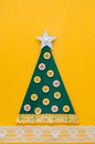 Handmade green christmas tree on yellow background Stock Photos
