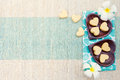 Handmade heart shape cookies on wooden plate and blue napkin Outdoor background Top view