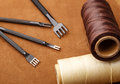 Handmade leather craft tool on brown background Stock Photography