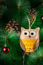 Handmade owl on the tree from felt christmas with cones Royalty Free Stock Images