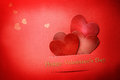 Handmade paper craft valentine hearts with happy valentines day text and small Stock Photography