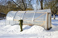 Handmade polythene greenhouse for vegetable in winter on snow Stock Image