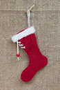 Handmade santa boot on burlap background for christmas decoration Stock Image