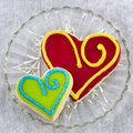 Handmade shortbread cookies heart shaped with icing and sprinkles on top Royalty Free Stock Photo