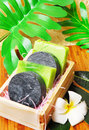 Handmade soap bars on bamboo mat with frangipani flowers and leaf Royalty Free Stock Photos