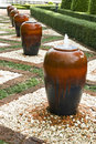 Handmade terracotta jar decorating a garden Stock Photography