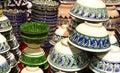 Handmade traditional crockery national uzbek kirghiz or kazakh ceramics piala tea bowls ware things made of clay on the shopboard Stock Photos