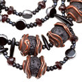 Handmade women necklace string of beads from garnet cooper and lava rock stone close up Royalty Free Stock Image
