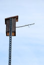 Handmade wooden bird house isolated on a blue sky background Royalty Free Stock Photos