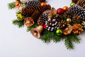 Handmade wooden Christmas jingle bell, fir branches and pine con Royalty Free Stock Photo
