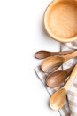 Handmade wooden spoons and wooden bowl. Royalty Free Stock Photo