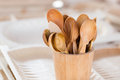Handmade wooden tea spoons in wooden basket Royalty Free Stock Photo