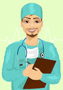 Handosme male doctor or nurse with stethoscope taking notes Royalty Free Stock Photo