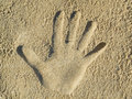 Handprint in the sand Royalty Free Stock Photography