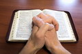 stock image of  Hands above the bible
