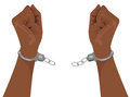 Hands of african american man breaking steel handcuffs