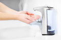 Hands and automatic soap dispenser Royalty Free Stock Photo