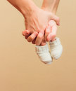 Hands with baby booties Royalty Free Stock Photo