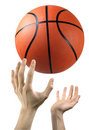 Hands and basketball Stock Images