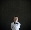 Hands behind back boy dressed up as business man teacher or student on blackboard background Royalty Free Stock Photos