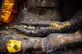 Hands of black Buddha statue Royalty Free Stock Photo