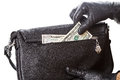Hands black gloves gets dollars his pocket bags Royalty Free Stock Photography