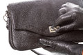 Hands black gloves opens handbag Royalty Free Stock Photography