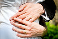 Hands of bride and groom with rings during the summer wedding. Royalty Free Stock Photo
