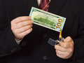Hands and burnning money Royalty Free Stock Photo