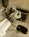 Hands of businessman addicted to work bond with mouse cable to computer laptop in workaholic Royalty Free Stock Photo
