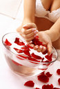 Hands care - rose petals bath Stock Images
