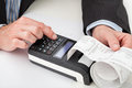 Hands with cash register Royalty Free Stock Photo