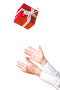 Hands catching the gift Royalty Free Stock Photos