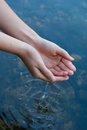 Hands catching water watr from river close up Stock Photos