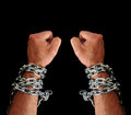 Hands with chains a as punch in black background Stock Photos