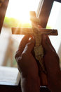 Hands with a christian cross, sunlight, pray, faith, religioun concept Royalty Free Stock Photo
