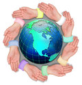 Hands circling world globe Stock Photo