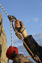 Hands of climber I work with equipment on rock. Stock Image